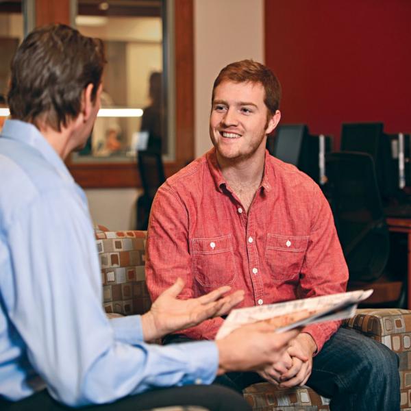 a student talks with a career center advisor